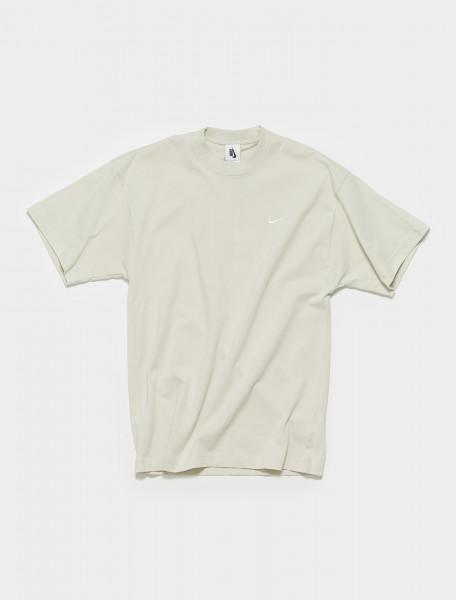 CV0559-072 NIKE NRG SOLO SWOOSH TEE IN LTBONE WHITE