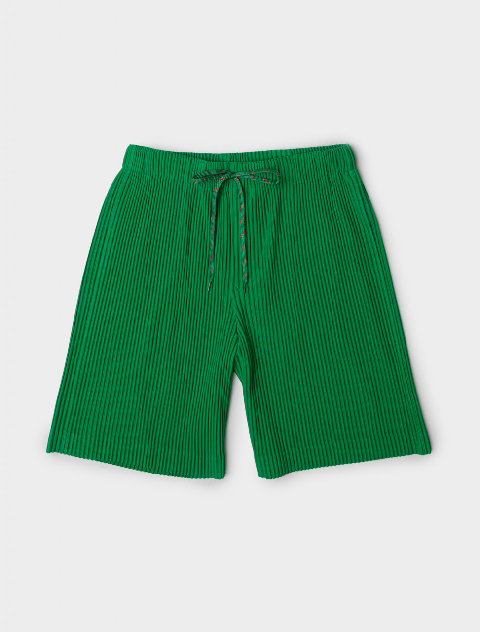 Front view of HOMME PLISSÉ Issey Miyake Drawstring Pleated Shorts in Green