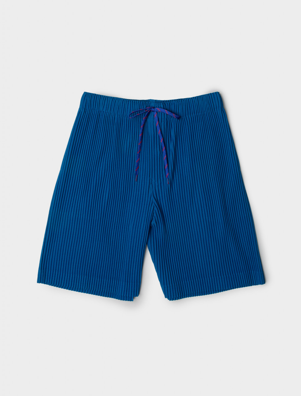 Front view of HOMME PLISSÉ Issey Miyake Drawstring Pleated Shorts in Blue