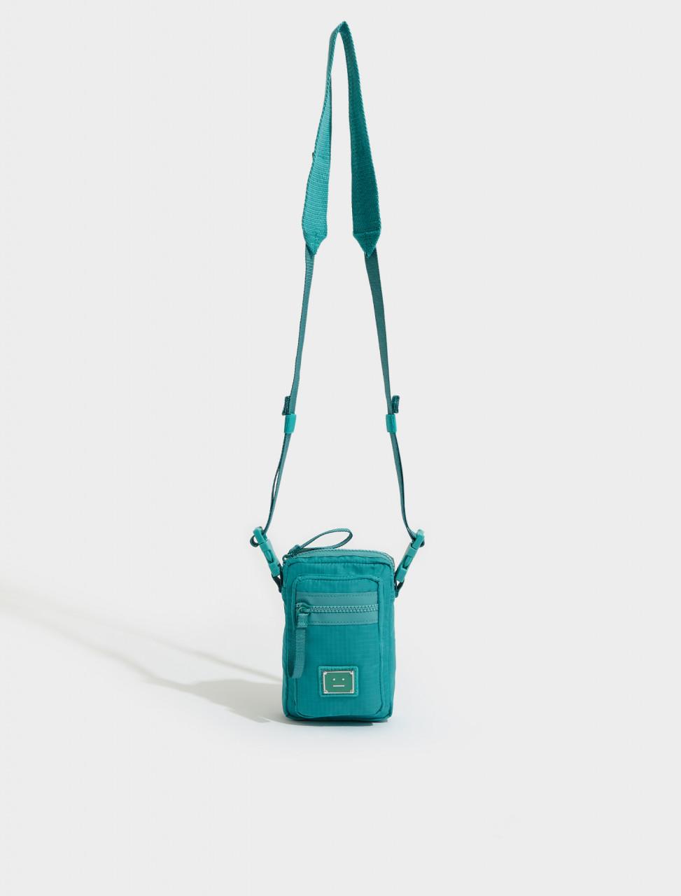 C10092-ABA-FA-UX-BAGS000020 ACNE STUDIOS ARVEL PLAQUE FACE LOGO POCKET BAG IN JADE GREEN