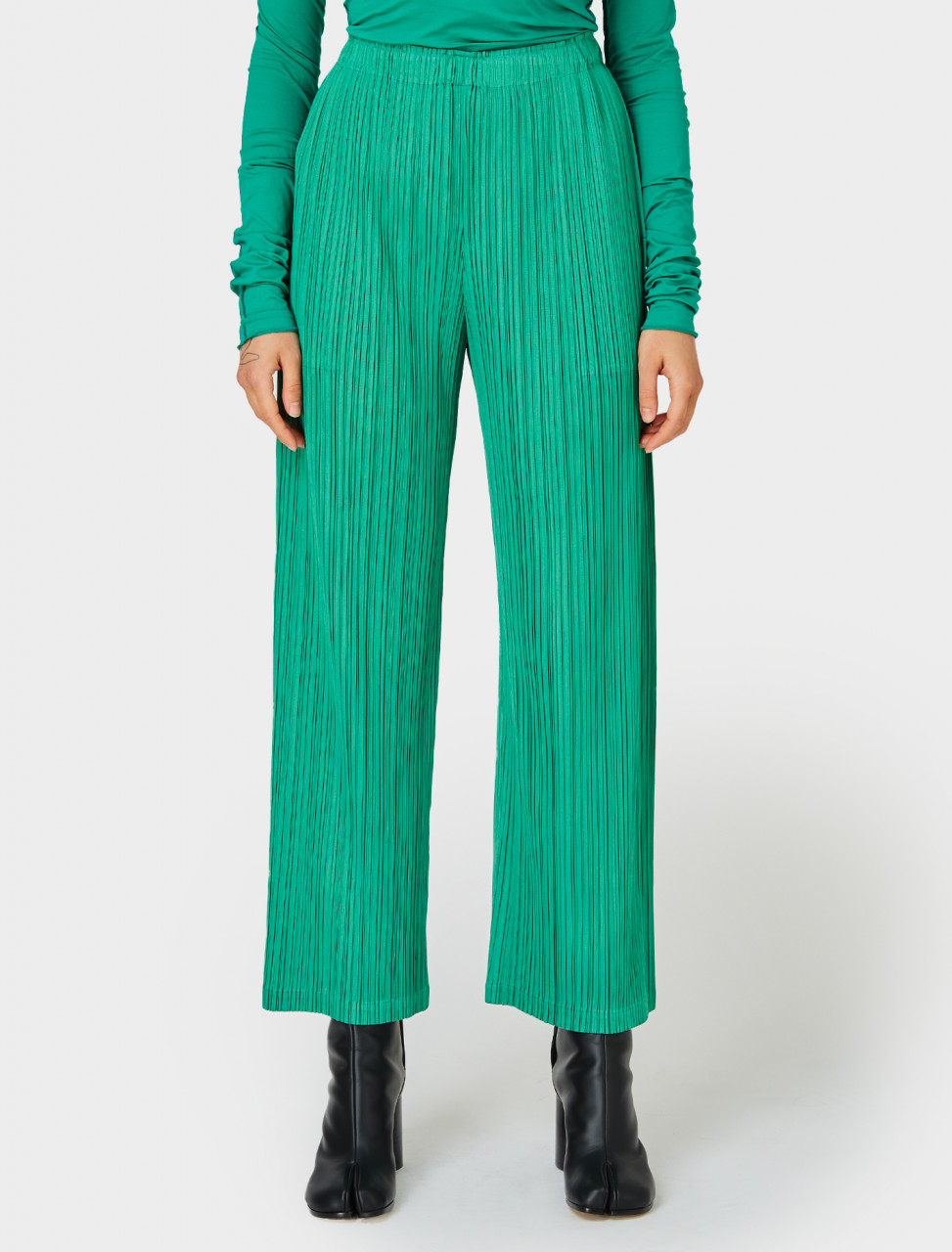 Front view of Pleats Please Issey Miyake Wide Leg Pleated Trousers in Green