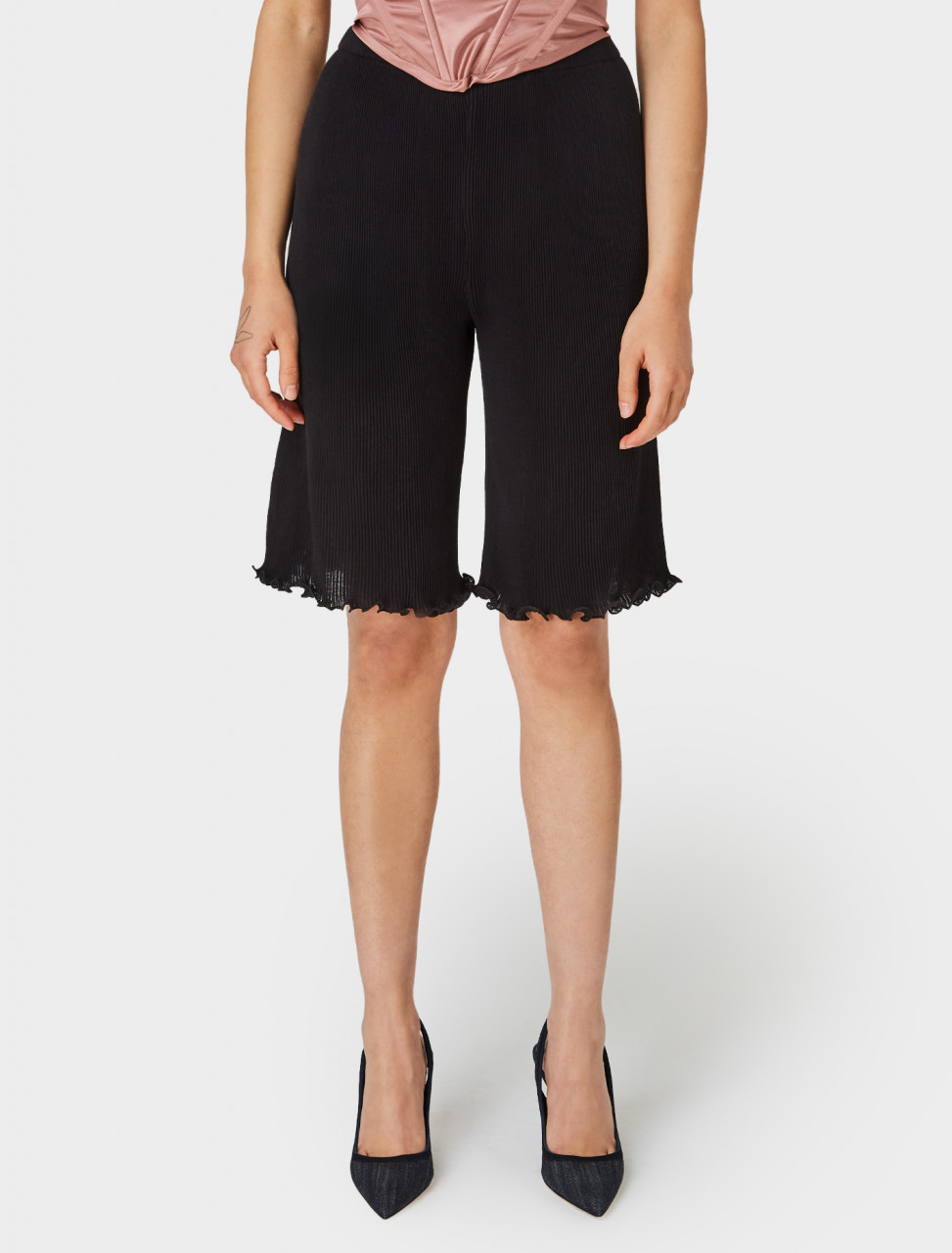 Front of Priscavera Seamless Pleated Shorts in Black