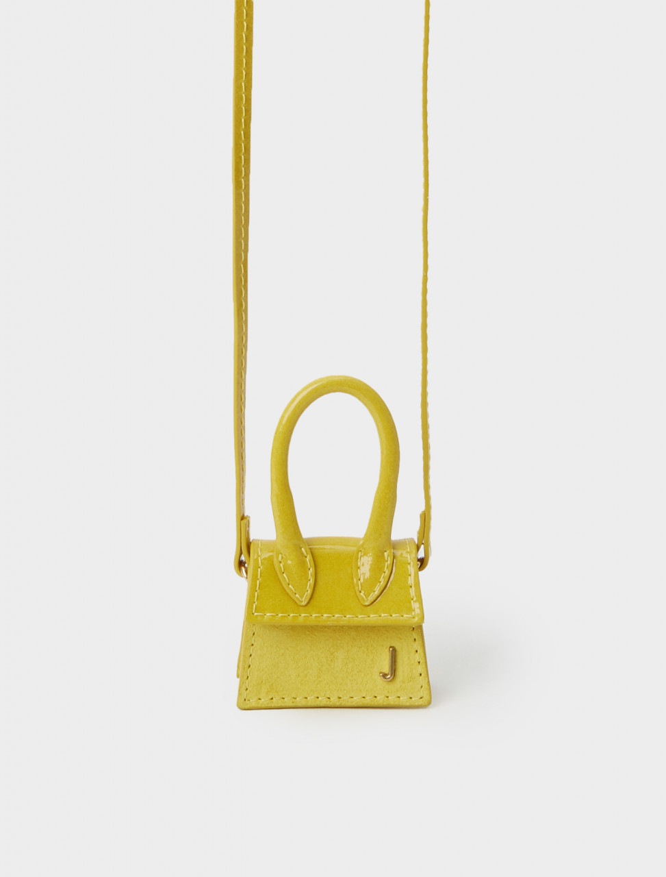 Front detail of Jacquemus Le Petit Chiquito in Shaded Yellow