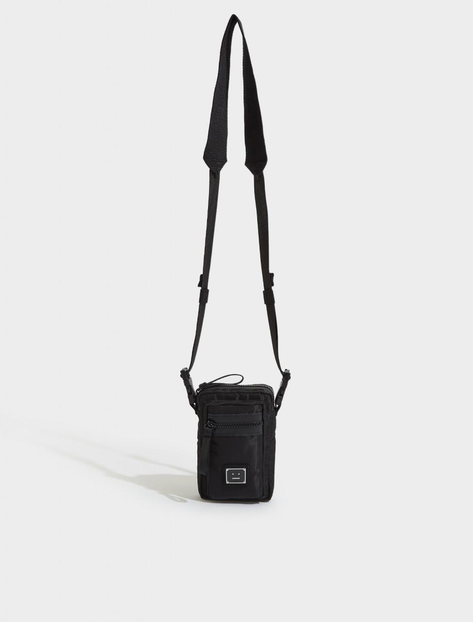 C10092-900-FA-UX-BAGS000020 ACNE STUDIOS ARVEL PLAQUE FACE LOGO POCKET BAG IN BLACK