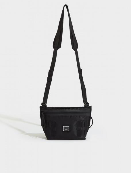C10093-900-FA-UX-BAGS000019 ACNE STUDIOS AGIOS PLAQUE FACE LOGO CROSSBODY BAG IN BLACK