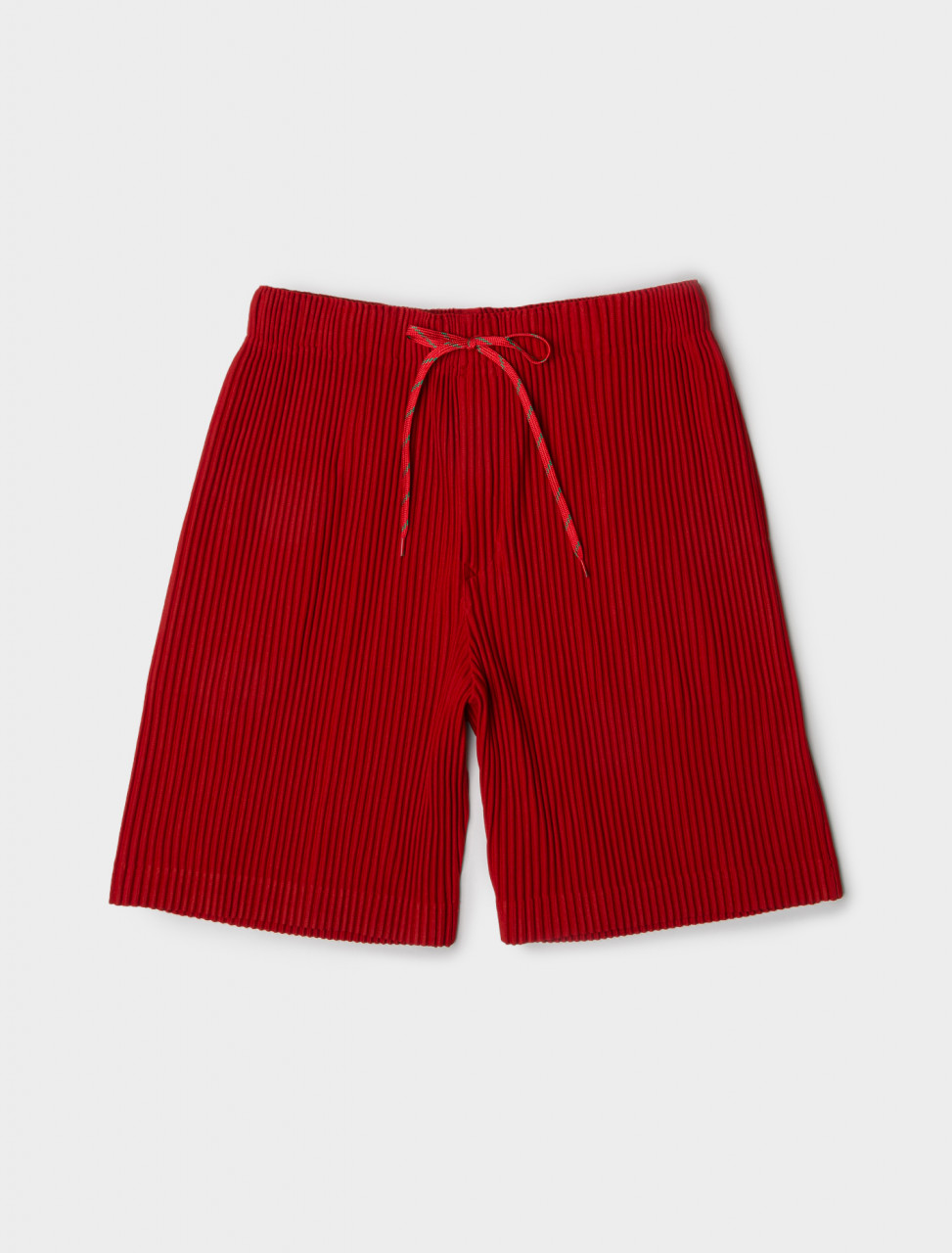 Front view of Issey Miyake Homme Plisse Drawstring Pleated Shorts in Red
