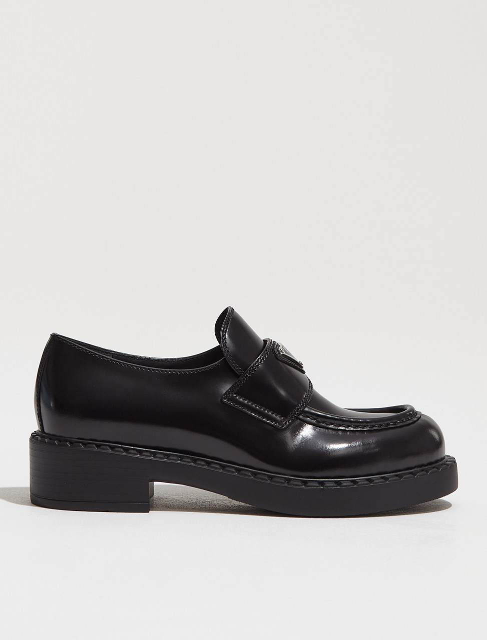 1D246M_ULS_F0002 PRADA BRUSHED LEATHER LOAFERS IN BLACK
